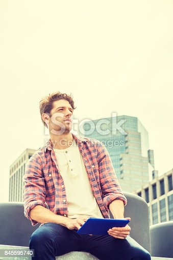 istock Young American man traveling, relaxing in New York 845595740