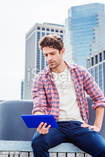 istock Young American man traveling, relaxing in New York 845595764
