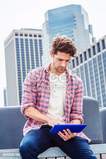 istock Young American man traveling, relaxing in New York 845595768