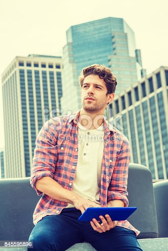 istock Young American man traveling, relaxing in New York 845595896