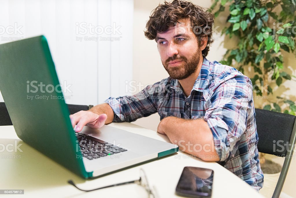 Young American Millennial Entrepreneur Working on Laptop Computer stock photo