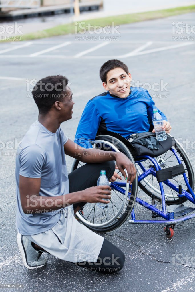 Young Amputee And Friend Athletes Taking Break Stock Photo