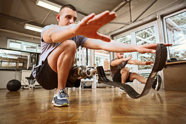 Young amputee exercising leg strength stock photo