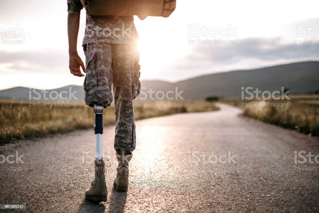 Young Amputee Soldier Coming Home stock photo