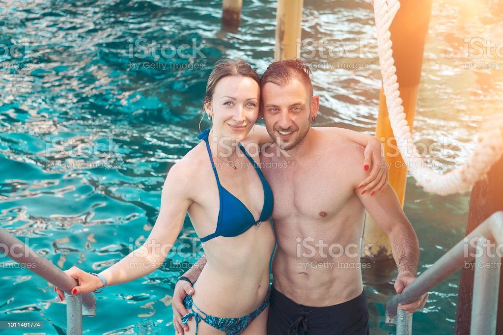Young and attractive couple in ocean. Dream vacation in tropical country stock photo