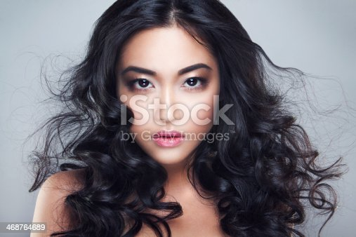 istock Young and beautiful asian woman with curly hair 468764689