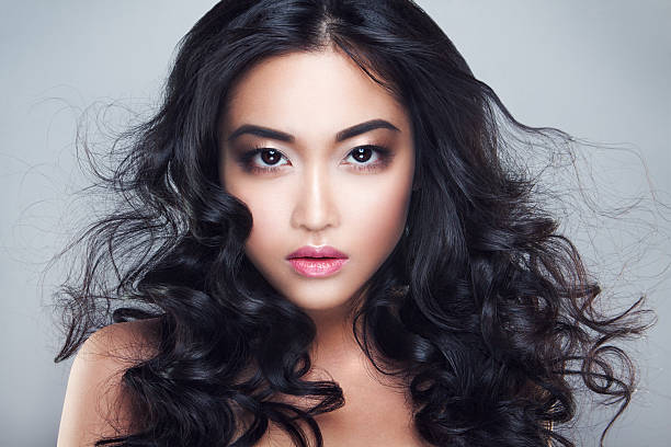 Young and beautiful asian woman with curly hair stock photo
