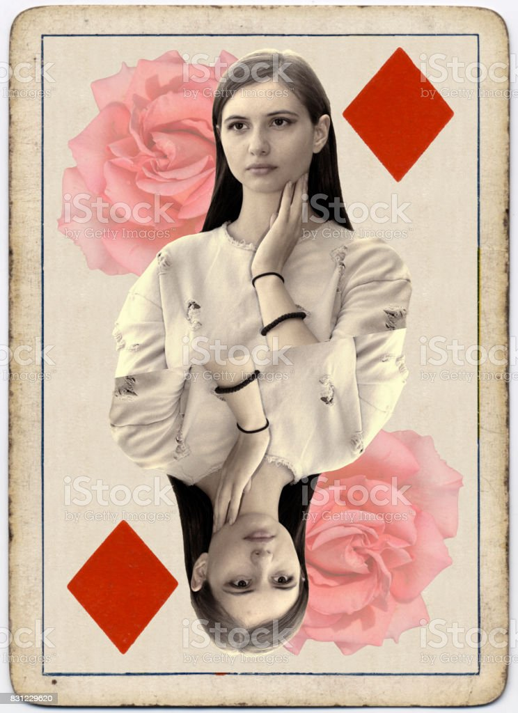 Young and beautiful Bulgarian outdoor girl queen of diamonds playing card stock photo