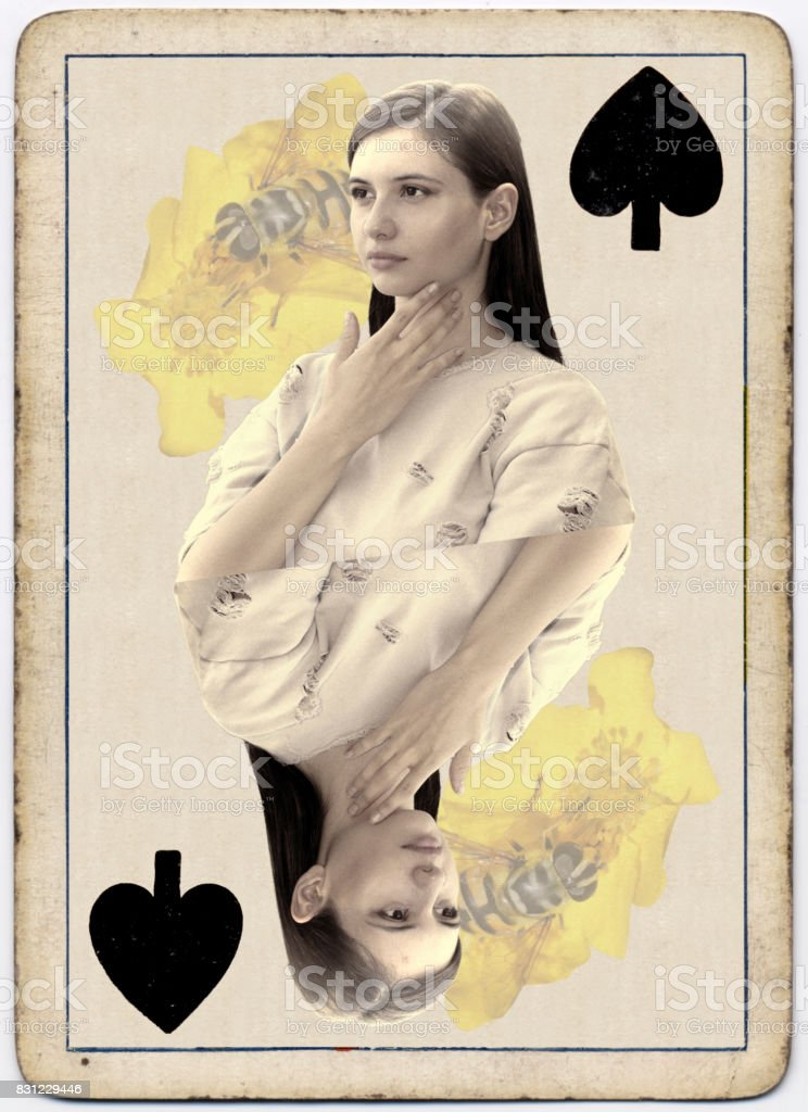 Young and beautiful Bulgarian outdoor girl queen of spades playing card stock photo
