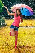 istock Young and beautiful woman have fun in rain 468413481