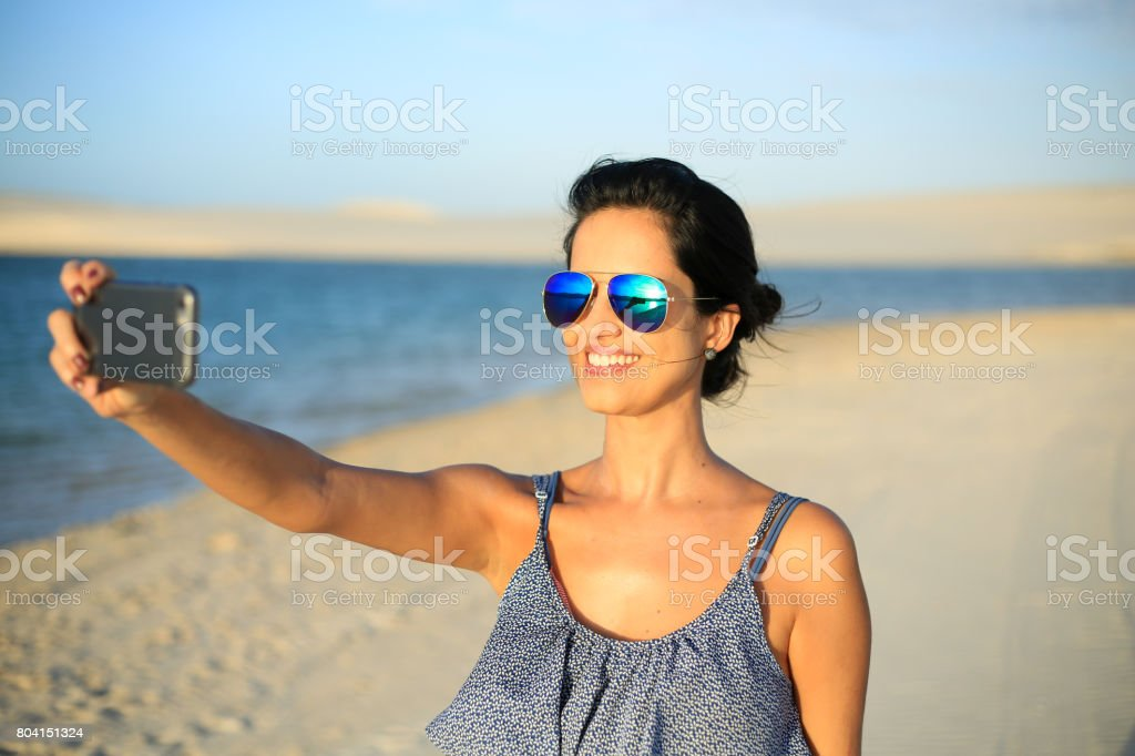 Young and beautiful woman taking a selfie