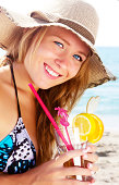 istock Young and beautiful woman with cocktail 175173439