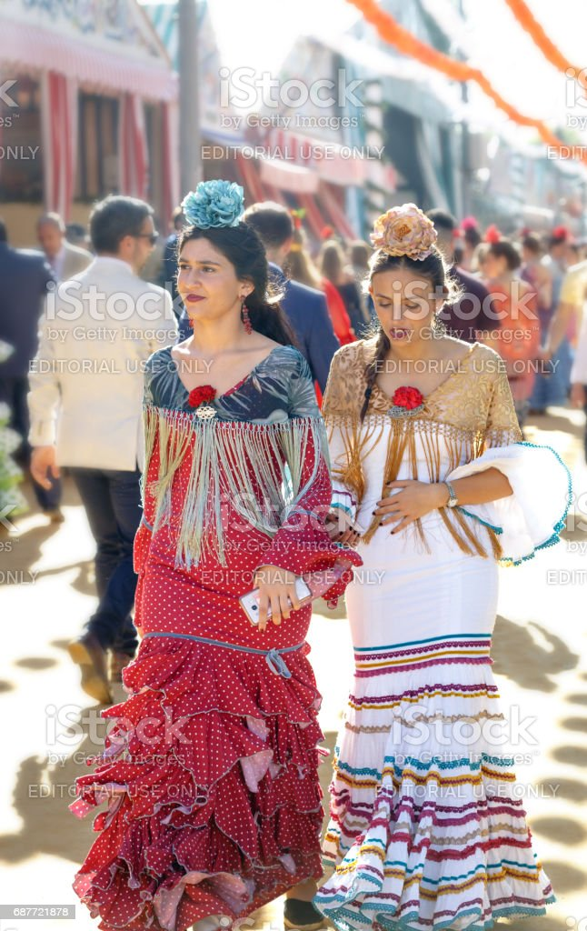 4c1b1e8b2 Young and beautiful women dressed in traditional costumes at the Seville's  April Fair. royalty-