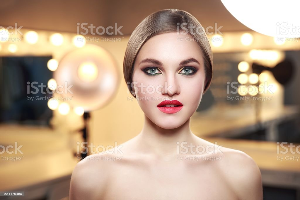 Young and beauty sexual woman standing in makeup room with stock photo