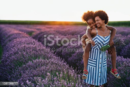 Afro daughter and her mother spending the day at lavender field