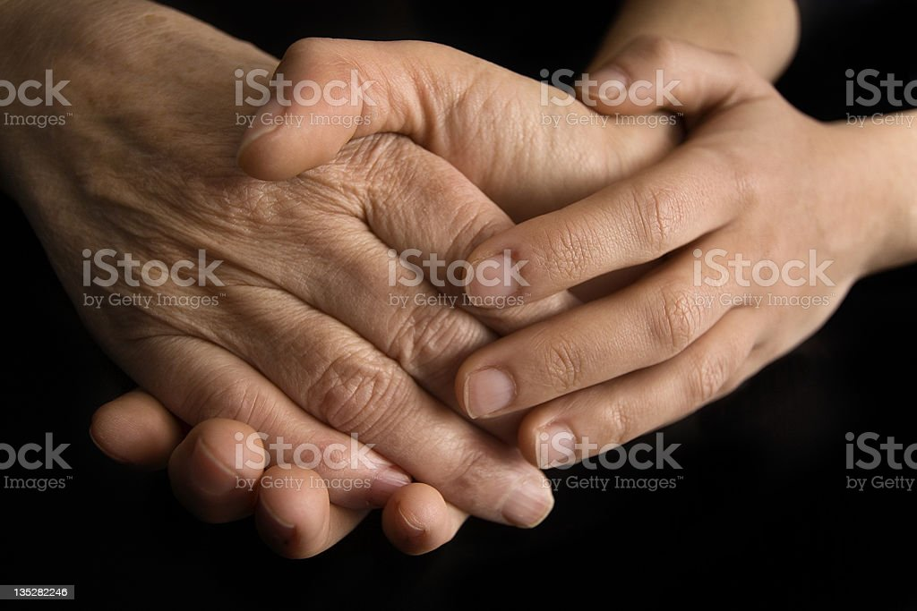 young and elderly hands royalty-free stock photo