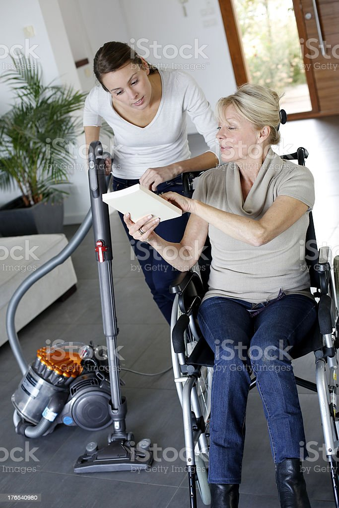 Young and  elderly women living together stock photo