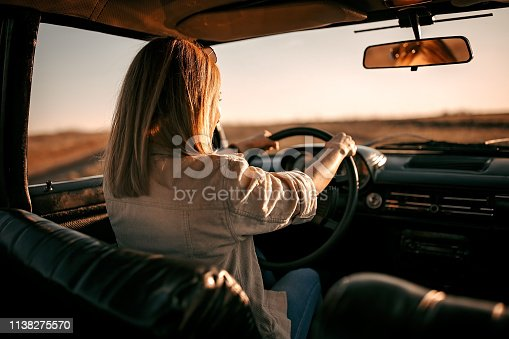 Woman driving in old timer car