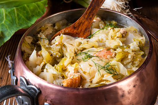 istock young and fresh cabbage cooked with bacon cubes 1019241542