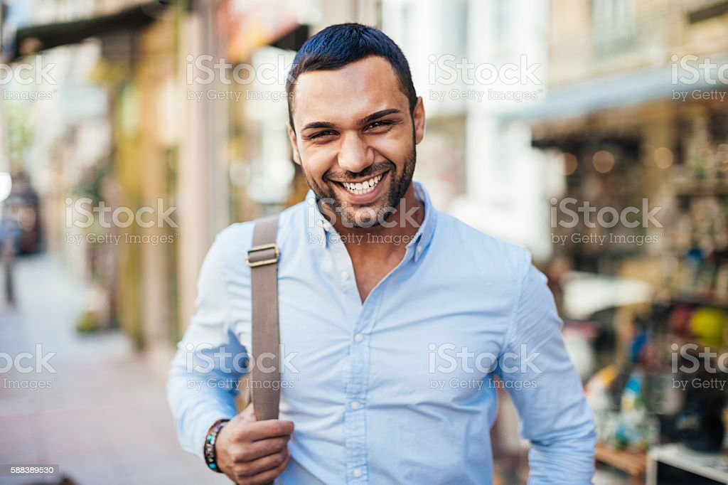 Young and happy Cheerful young man walking on the street. 20-29 Years Stock Photo
