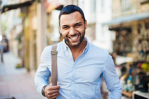 Young and happy Cheerful young man walking on the street. turkey middle east stock pictures, royalty-free photos & images