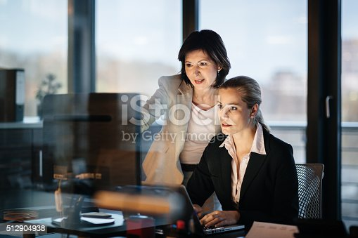 istock Young and Mature Business Woman Working Late 512904938
