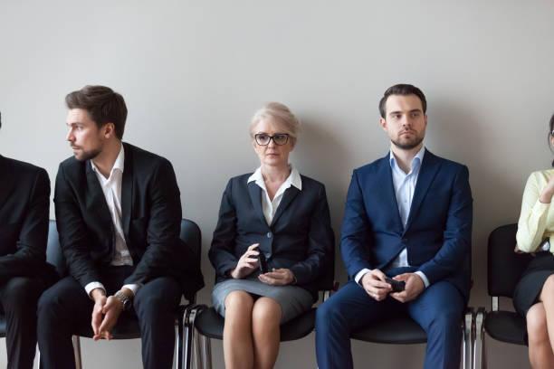 unga och äldre kandidater väntar på anställningsintervju i office - new job bildbanksfoton och bilder