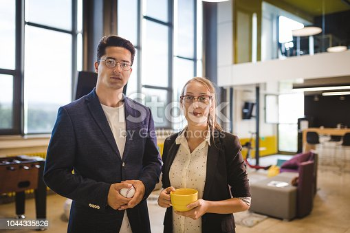 624700110istockphoto Young and modern business people standing in the office 1044335826