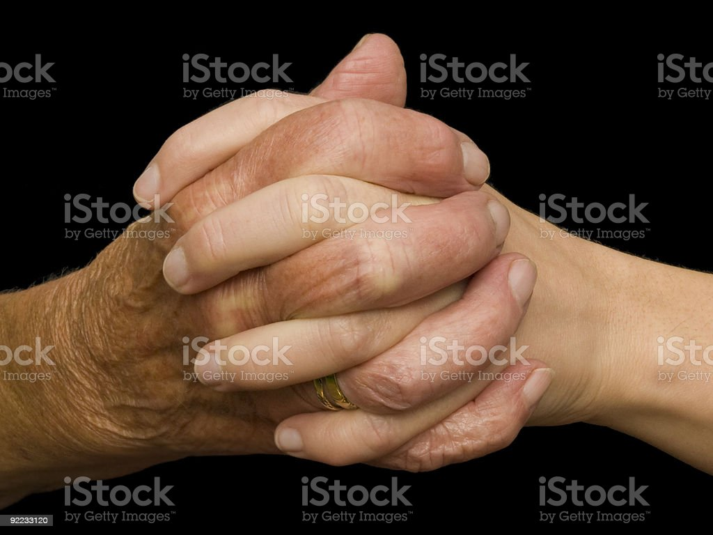 Young and old hand folded stock photo
