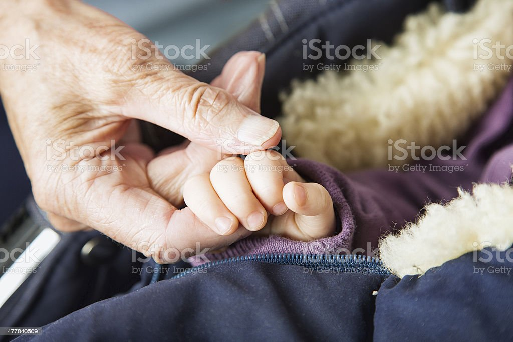 young and old hands baby ocotgenerian woman royalty-free stock photo