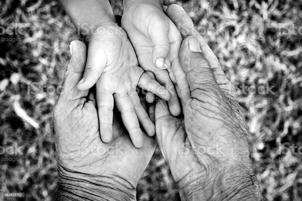 Young and old hands stock photo