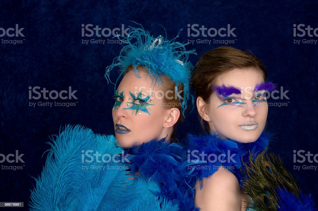 Young and old showgirls. stock photo