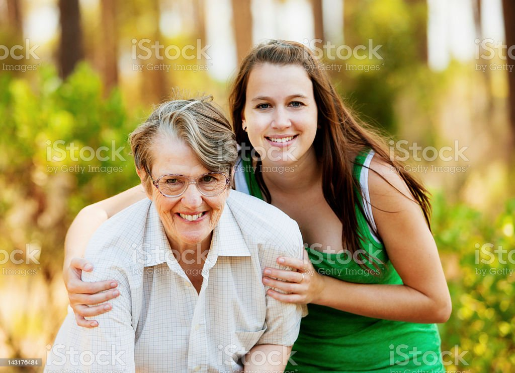 Young and old woman embrace: no generation gap here stock photo