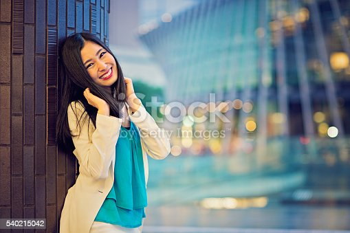istock Young and playful Japanese woman is posing 540215042