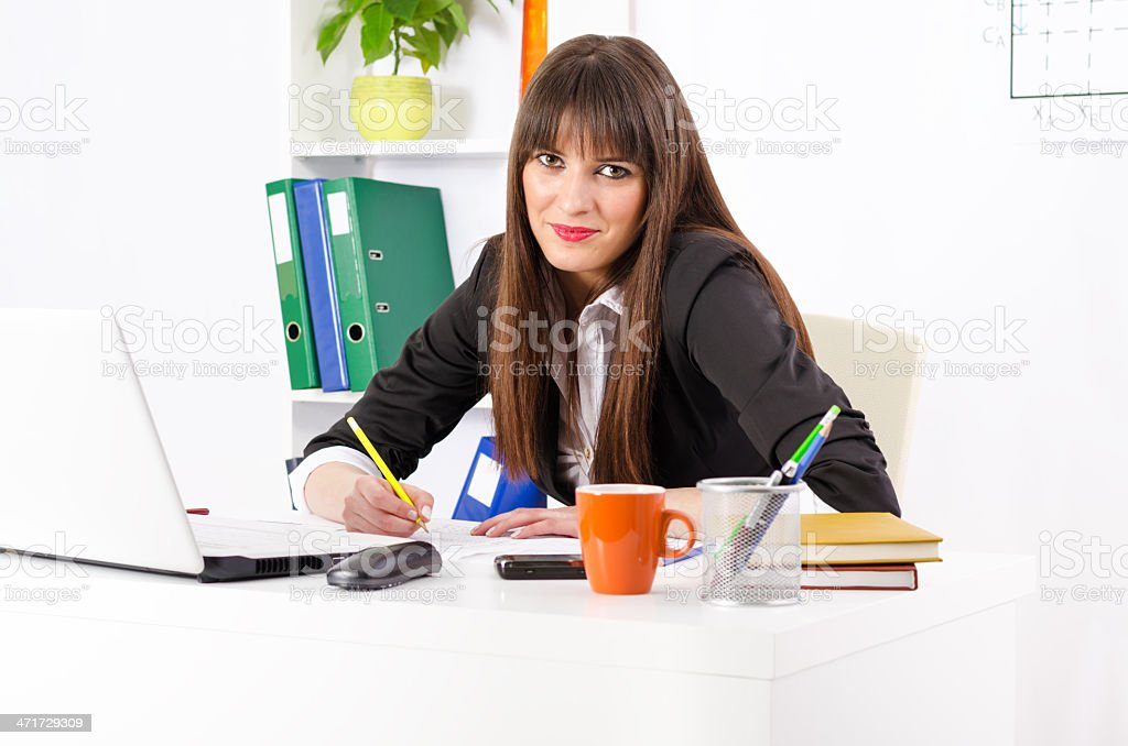 Young and pretty businesswoman in her office working royalty-free stock photo