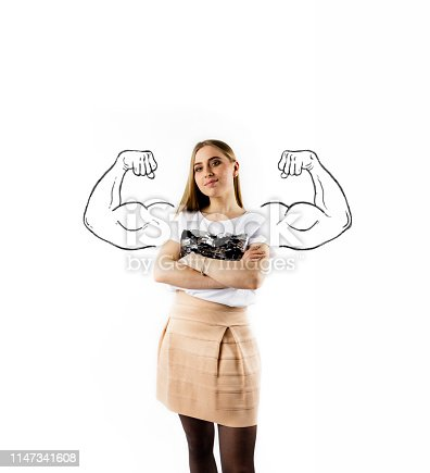 istock Young and strong woman in white. Strong woman concept. 1147341608