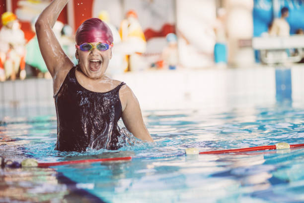 young and successful swimmers pose stock photo