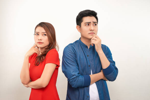 Young angry couple in love standing back to back Young angry couple in love standing back to back former stock pictures, royalty-free photos & images