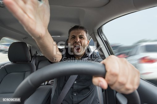 istock Young angry man driving his vehicle 928096358
