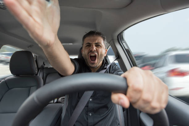 young angry man driving his vehicle - aggression stock photos and pictures