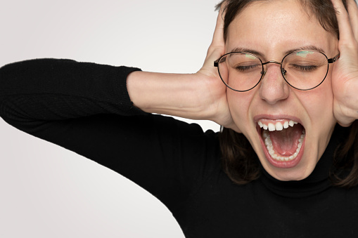 487960859 istock photo Young Angry woman shouting overt isolated gray background 1214933667