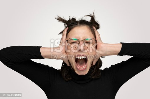 Young Angry woman shouting overt isolated gray background