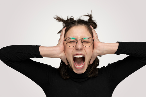 487960859 istock photo Young Angry woman shouting overt isolated gray background 1214933838