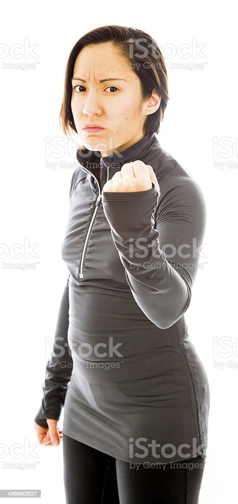 Young angry woman with fist up isolated on white background stock photo