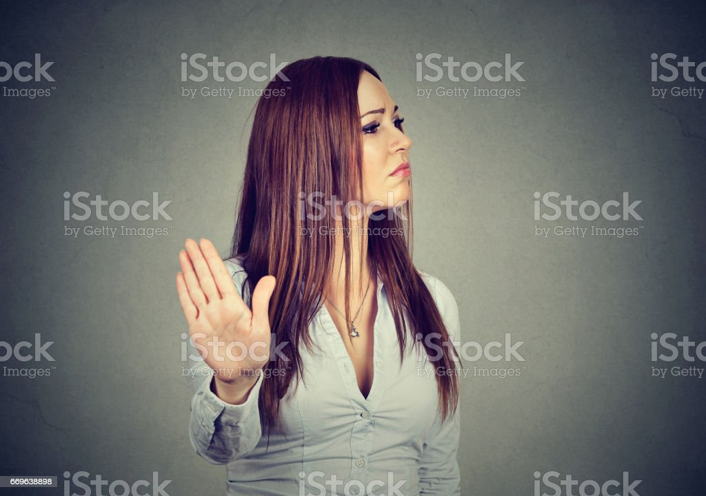 young annoyed angry woman giving talk to hand gesture with palm outward stock photo