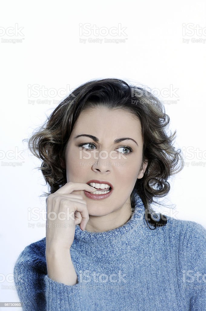 young annoyed woman biting his finger royalty free stockfoto