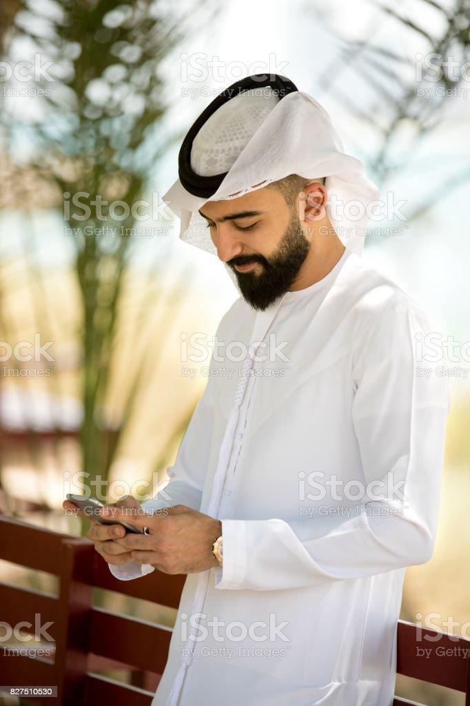 Young arab using smart phone stock photo