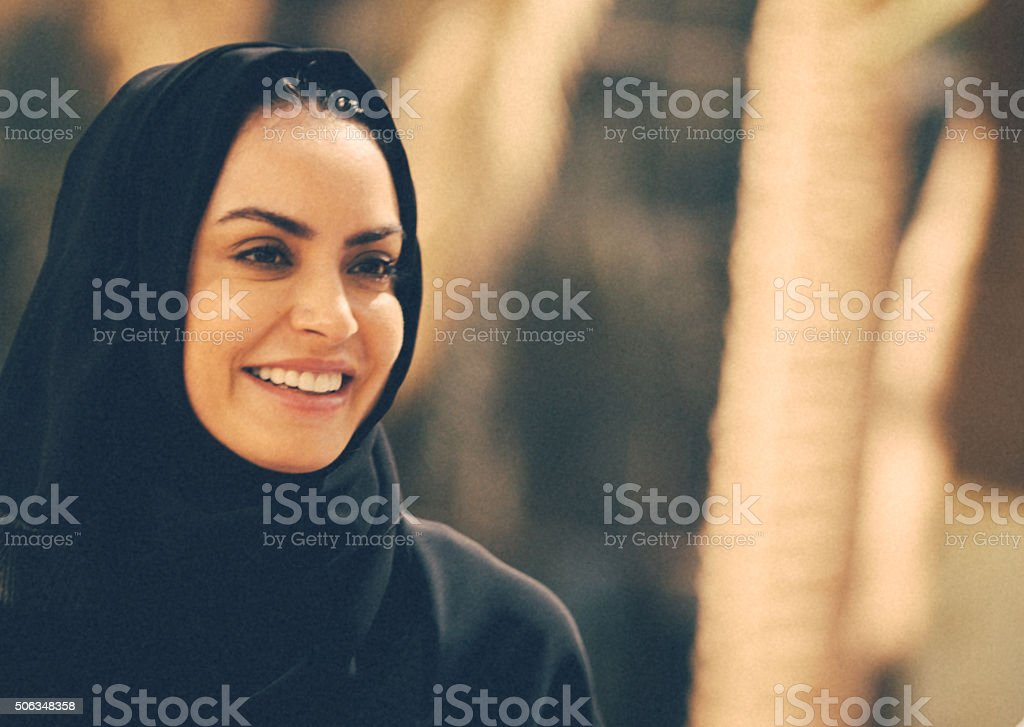 Young Arab Woman in a park stock photo
