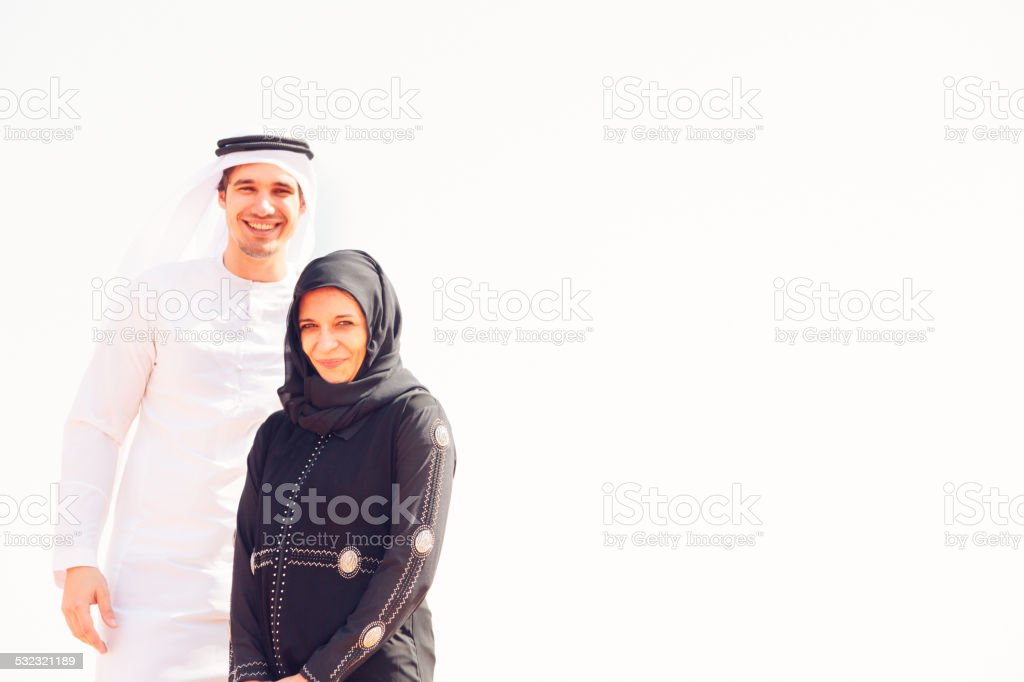 young arabian couple in the desert stock photo