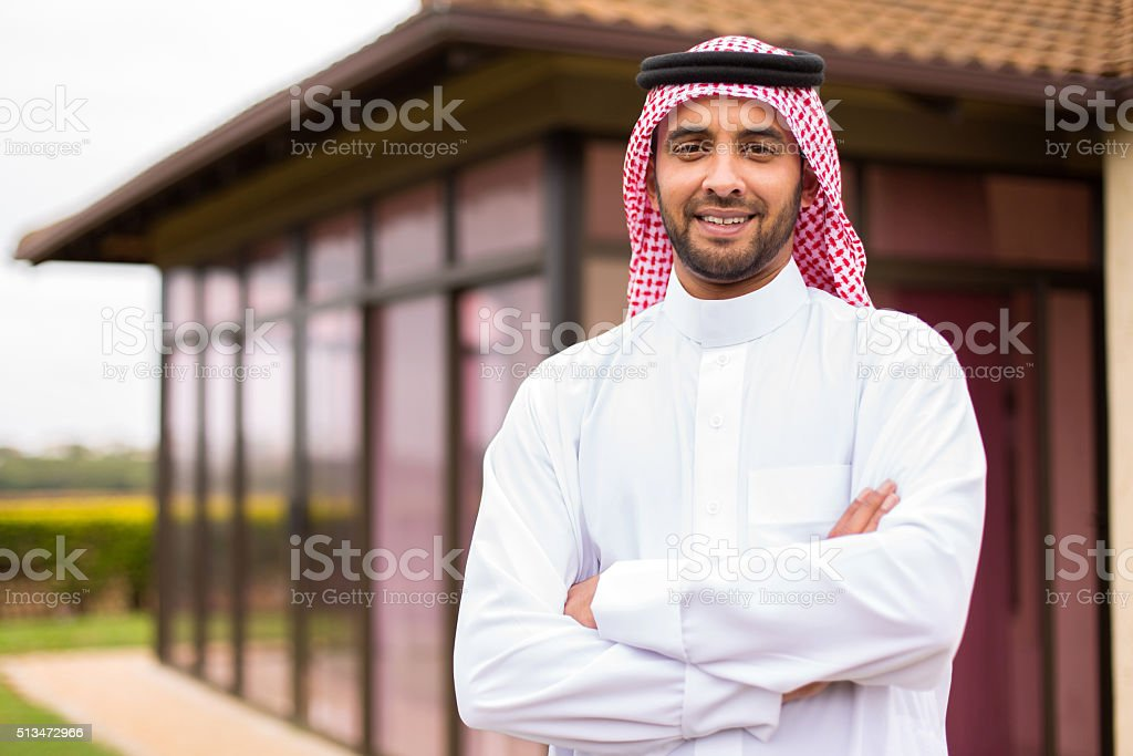 young arabian man with arms crossed stok fotoğrafı